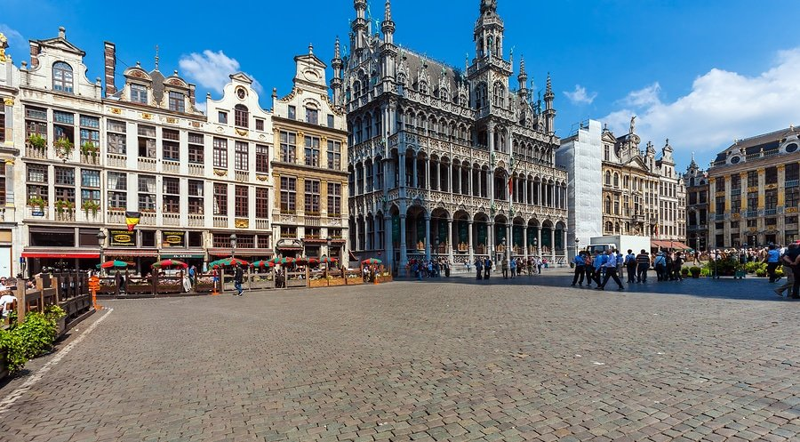 The Grand Place or Grote Markt is the central square of Brussels. It is surrounded by opulent guildhalls and two larger edifices, the city's Town Hall, and the Breadhouse building containing the Museum of the City of Brussels