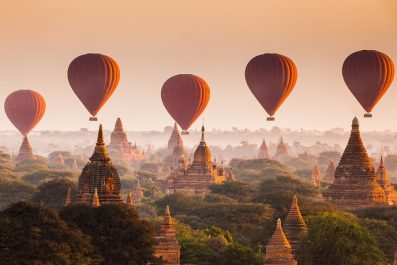 Balloons Over Plain Of Bagan In Misty Morning, Myanmar