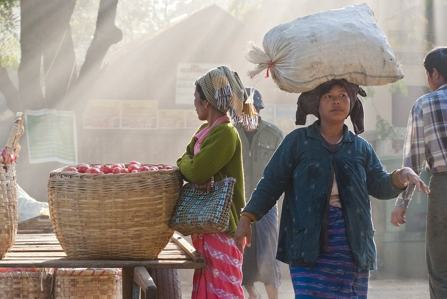 Locals at the Nyaung-U market, Myanmar. It is a local market where people come from all over the area to sell and buy products.