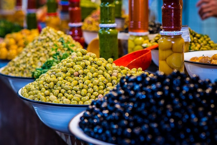 Moroccan dishes are full of color... even the olive display looks like art