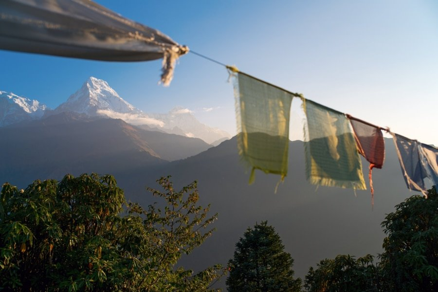 Prayer flags with Annapurna in the background. Poon Hill Ghorepani