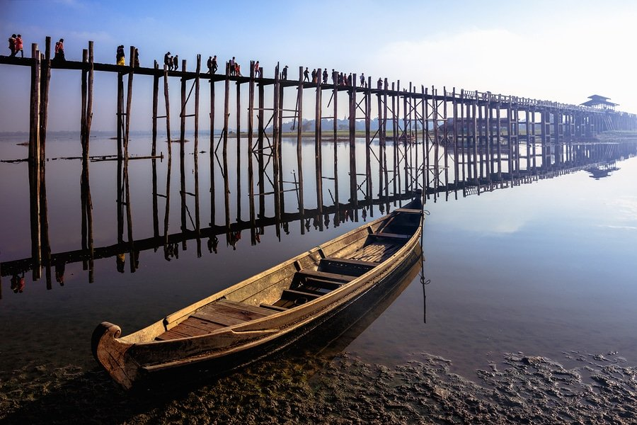 U bein bridge with vintage boat. U bein bridge is longest teak bridge in the world, Mandalay, Myanmar