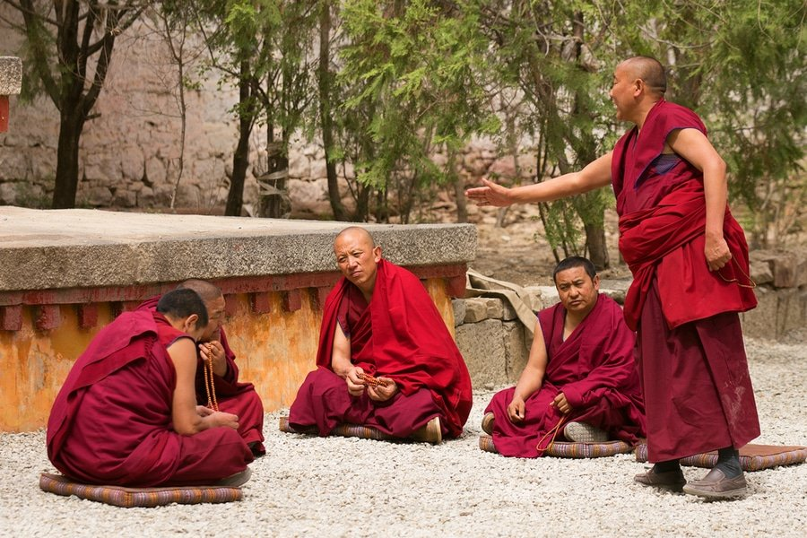 Buddhist monks at debates in Sera monastery, Tibet