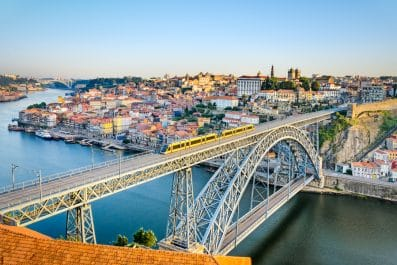 View of the historic city of Porto, Portugal with the Dom Luiz bridge