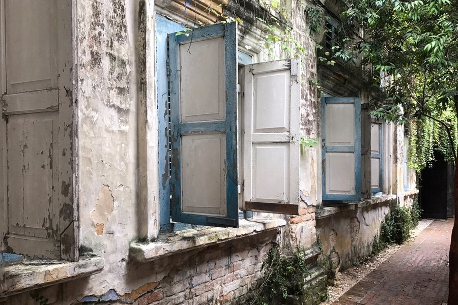 A row of open windows of an old building in historical old town of Ipoh, Malaysia