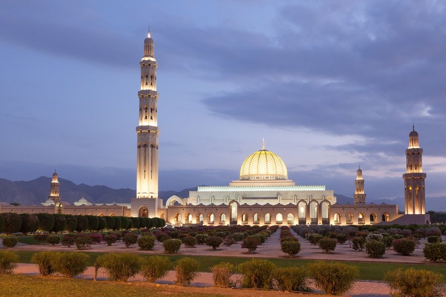 The Sultan Qaboos Grand Mosque illuminated at dusk, Muscat, Oman
